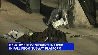 Bank robbery suspect critically injured in fall from subway platform in Queens