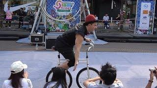 Double Unicycle Rider Amuses Audience