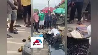 AFRICA - people selling food from gutter for public consumption