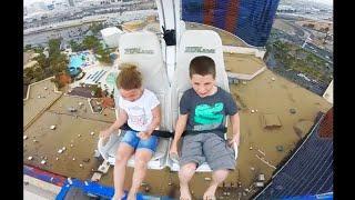 kid falls off roller coaster, lands on..