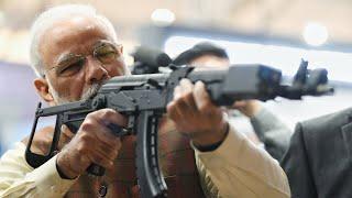 PM Narendra Modi visits DefExpo 2020, tries his hand at Gun