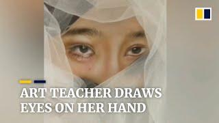 Art teacher in China draws realistic facial features on her hand
