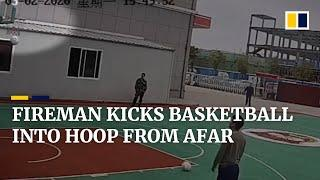 Chinese fireman kicks basketball from outside the court into hoop