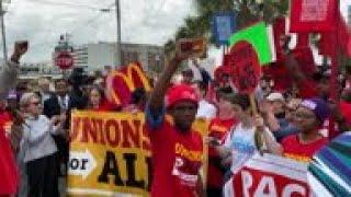 Protesters hound Buttigieg at minimum wage march