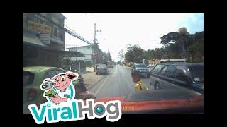 Mother Dives into Traffic to Save Child || ViralHog